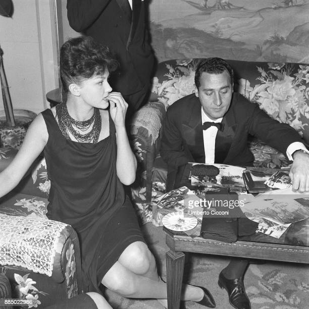 Italian actor Alberto Sordi is with French actress Isabelle Corey in a party Naples 1959