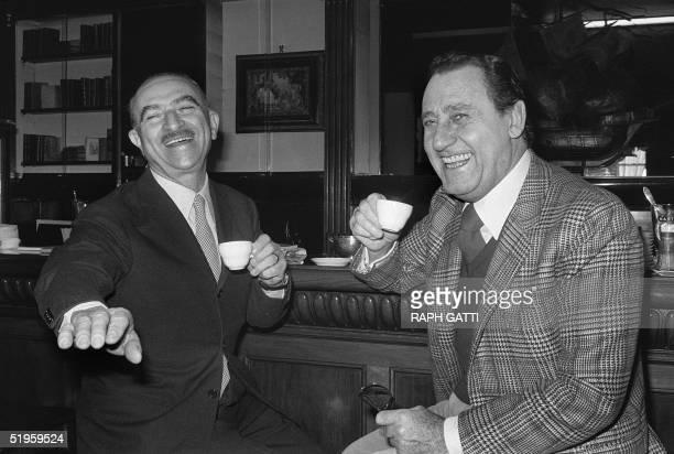Italian actor Alberto Sordi laughs with Italian director Alberto Lattuada as they drink a coffee 14 December 1980 in Nice during the Italian Film...
