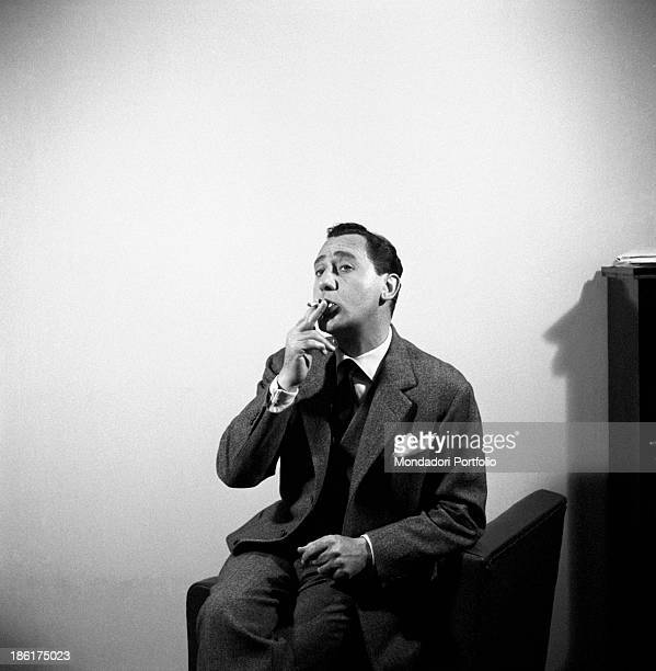 Italian actor Alberto Sordi smoking a cigarette Sordi is playing William Il Dentone the leading character of the episode William Il Dentone from the...