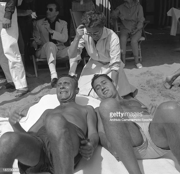 Italian actor Alberto Sordi with Paolo Stoppa sunbathing on the Lido beach Lido Venice 1957