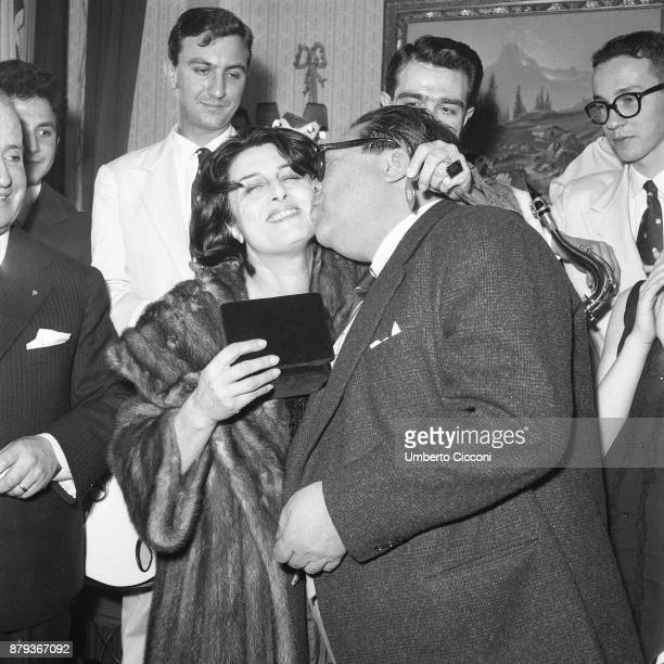 Italian actor Aldo Fabrizi kisses Italian actress Anna Magnani