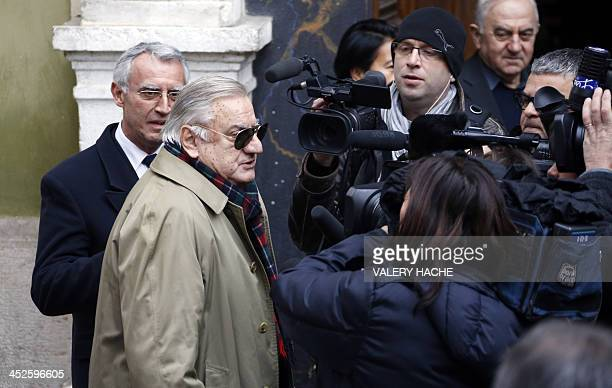 Italian actor Aldo Maccione arrives to attend the funeral of French film director Georges Lautner in Nice southeastern France on November 30 2013...