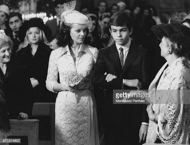 Italian actor Alessandro Momo and Italian actress Laura Antonelli in wedding dress walking in the nave of the church in the film Malicious Italy 1973