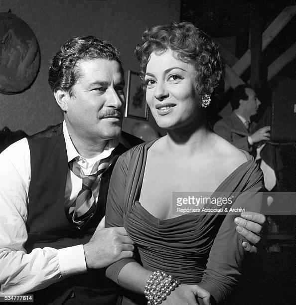 Italian actor Amedeo Nazzari hugging Greekborn Italian actress Yvonne Sanson during a break on the set of the film Nobody's Children 1951