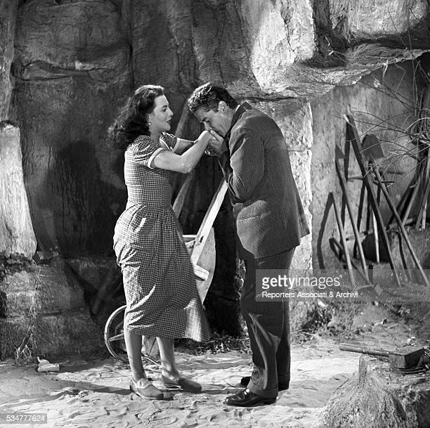 Italian actor Amedeo Nazzari kissing Greekborn Italian actress Yvonne Sanson's hands in the film Nobody's Children 1951