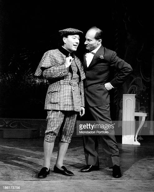 Italian actor and comedian Erminio Macario talking to Italian actor Carlo Rizzo in the musical comedy Chiamate Arturo 777 at the Teatro Lirico Milan...