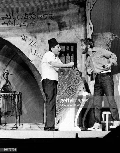 Italian actor and comedian Erminio Macario wearing a fez and talking to a young actor in the musical comedy Chiamate Arturo 777 at the Teatro Lirico...