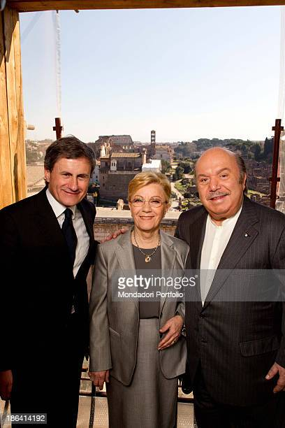 Italian actor and comedian Lino Banfi and his wife Lucia smiling with mayor Gianni Alemanno in Campidoglio Lino Banfi received the Capitoline Wolf in...