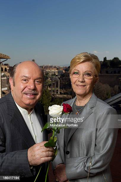 Italian actor and comedian Lino Banfi offering two roses to his wife Lucia The couple celebrated their 50th wedding anniversary making the wedding...