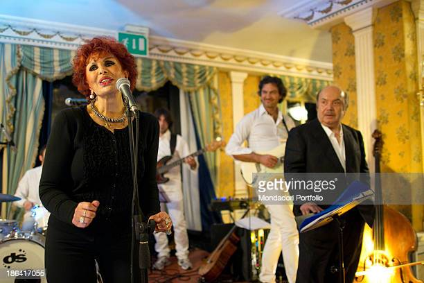Italian actor and comedian Lino Banfi performing with Italian writer and singer Maria Scicolone during the reception at the hotel Parco dei Principi...