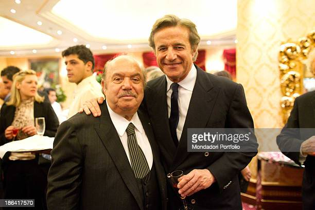 Italian actor and comedian Lino Banfi posing beside Italian actor director and singer Christian De Sica during the reception at the hotel Parco dei...
