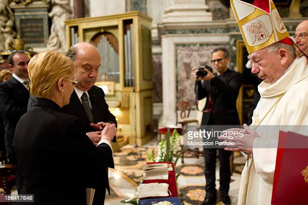 Italian actor and comedian Lino Banfi receiving the wedding ring from his wife Lucia during the ceremony officiated by Italian cardinal and...