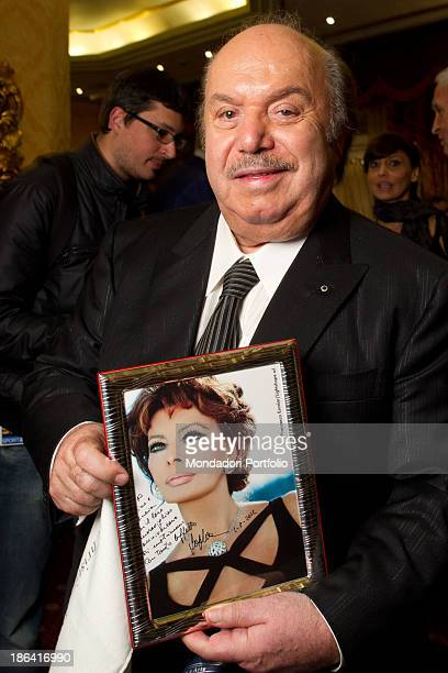 Italian actor and comedian Lino Banfi showing an autographed portrait of Italian actress Sophia Loren during the reception at the hotel Parco dei...