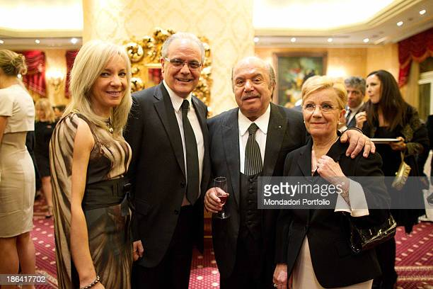 Italian actor and comedian Lino Banfi smiling beside his wife Lucia and Italian journalist and director of Raiuno Mauro Mazza and his wife during the...
