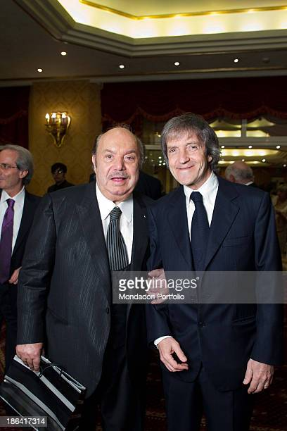 Italian actor and comedian Lino Banfi taking Italian director and producer Carlo Vanzina by the arm during the reception at the hotel Parco dei...