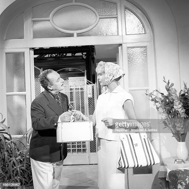 Italian actor and comedian Nino Taranto looking into Italian actress Alessandra Panaro's eyes in a scene from the film Avventura a Capri Capri 1958