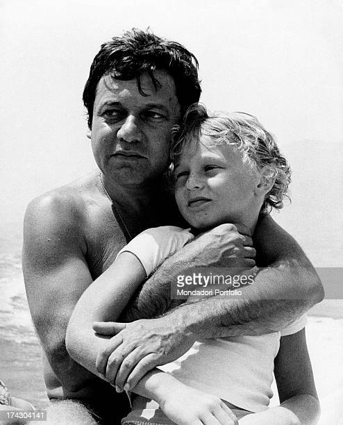 Italian actor and comedian Paolo Villaggio points to something in the waters of Isle of Capri, aboard of his motorboat together with his wife Maura,...