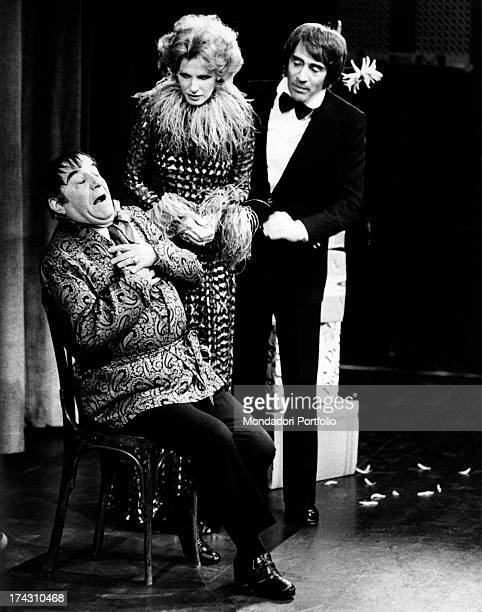 Italian actor and comedian Walter Chiari and Italian singer and actress Ornella Vanoni looking at Italian actor Carlo Campanini in Io con te, tu con...
