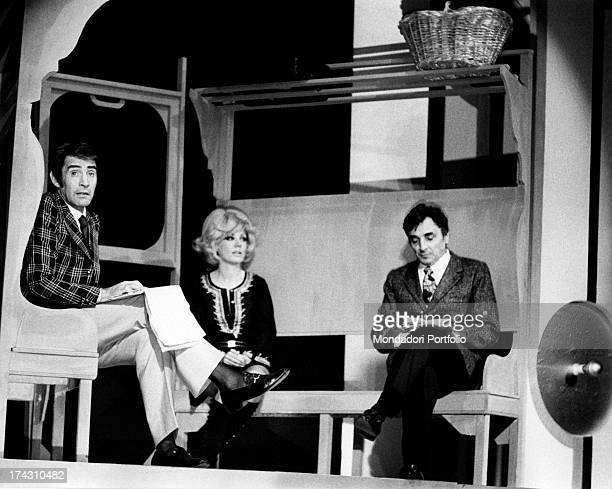 Italian actor and comedian Walter Chiari Italian actress Emy Eco and Italian actor Gianni Cajafa playing Sarchiapone sektch in Nude Look Brescia 1971