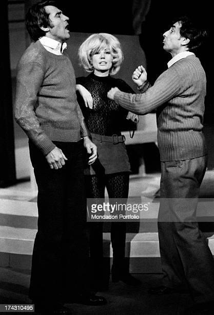 Italian actor and comedian Walter Chiari Italian actress Emy Eco and Italian actor Gianni Cajafa joking during a break of Nude Look Brescia 1971
