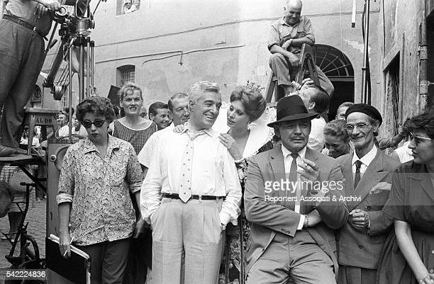 Italian actor and direcor Vittorio De Sica American actor Clark Gable and Italian actress Sophia Loren during a break on the set of It Started in...