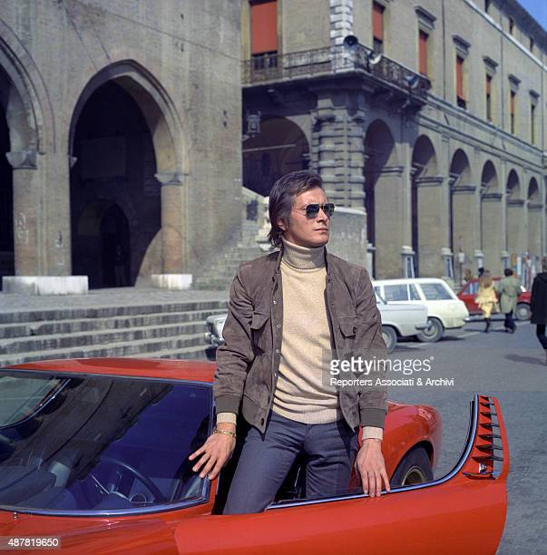 Italian actor and director Adalberto Maria Merli getting out of the car in the film Indian Summer Italy 1972