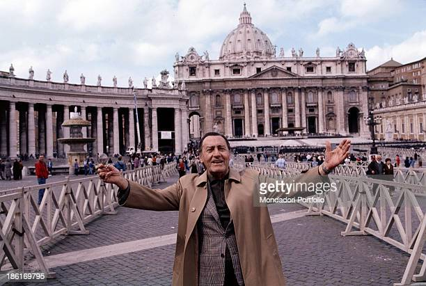 Italian actor and director Alberto Sordi opening his arms wide in front of St. Peter's Basilica. Vatican City, 1996.