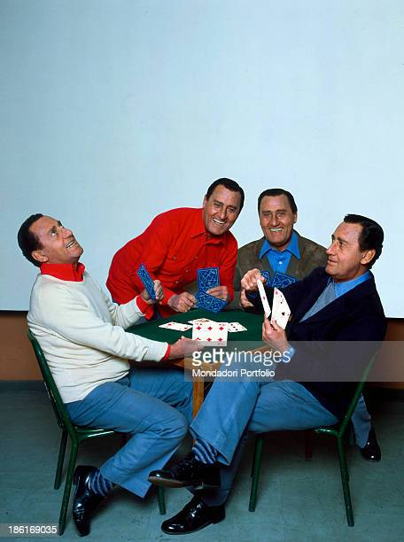 Italian actor and director Alberto Sordi playing cards with himself in a photomontage 1981