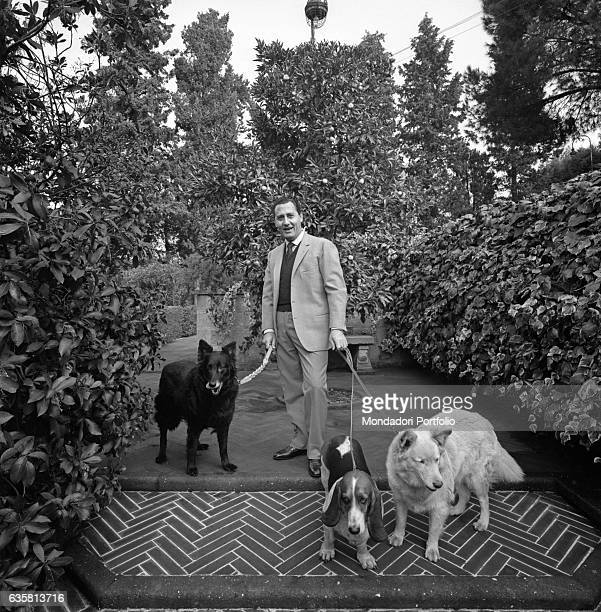 Italian actor and director Alberto Sordi posing with his three dogs at the entrance of his house on via Druso nearby the Baths of Caracalla Rome 5th...
