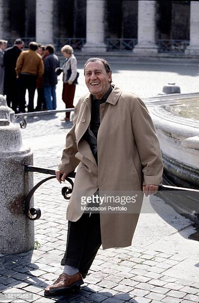 Italian actor and director Alberto Sordi sitting beside a fountain in St Peter's Square Vatican City 1996