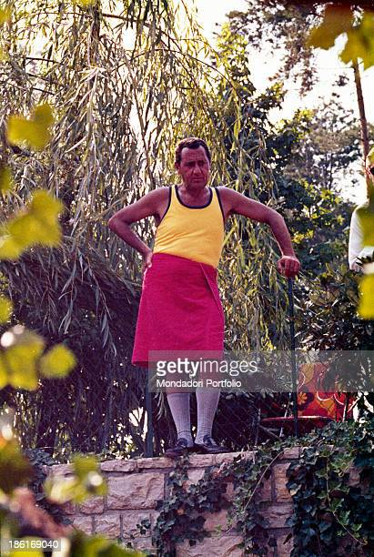Italian actor and director Alberto Sordi with a towel tied around the waist acting in the film While There's War There's Hope 1974