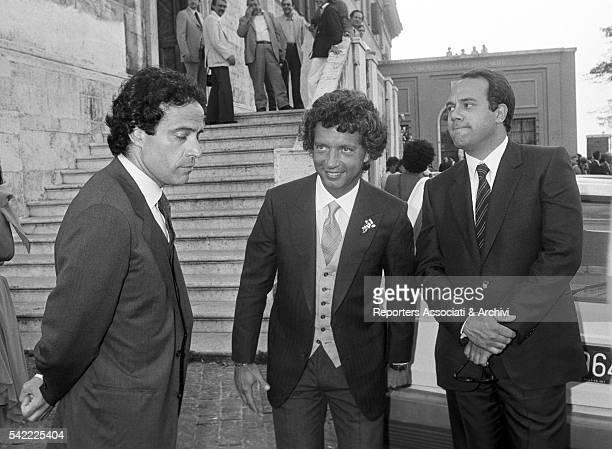 Italian actor and director Carlo Verdone and Italian actor Enrico Montesano at the wedding of Rita Rusic with Italian producer Vittorio Cecchi Gori...