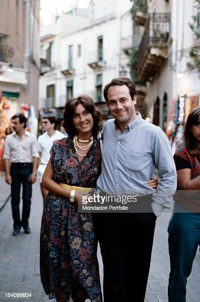 Italian actor and director Carlo Verdone posing with his wife Gianna Scarpelli. 1980s