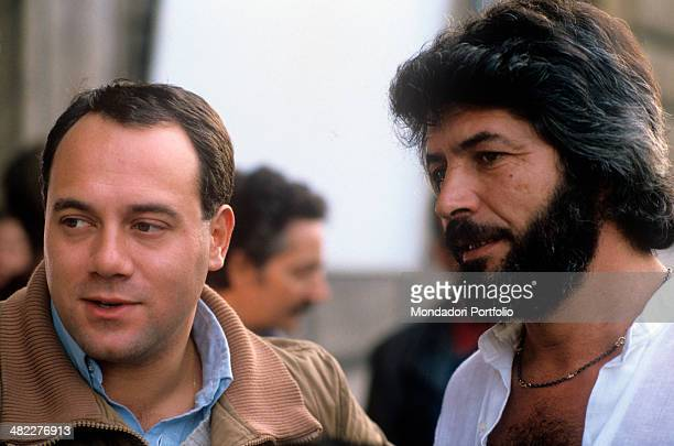 Italian actor and director Carlo Verdone talking to Italian actor Angelo Infanti on the set of the film Bianco rosso e Verdone 1981