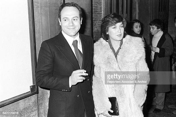 Italian actor and director Carlo Verdone, with his wife Gianna Scarpelli, at the wedding of his sister Silvia with Christian De Sica. Rome, 1980