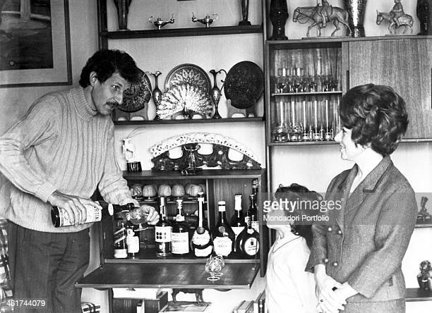 Italian actor and director Ciccio Ingrassia who established the comedy duo CiccioFranco with Franco Franchi pours a Martini in front of a mobile bar...