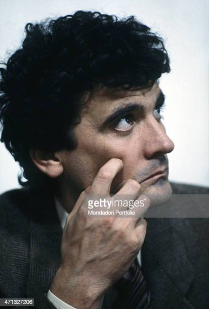 Italian actor and director Massimo Troisi acting thoughtful in the film Scusate il ritardo 1983