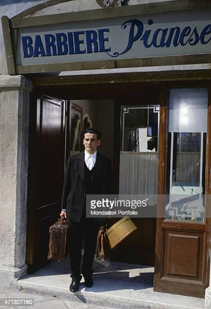 Italian actor and director Massimo Troisi as a barber acting in the film Le vie del Signore sono finite 1987