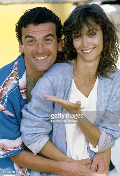 Italian actor and director Massimo Troisi smiling and hugging British actress Rachel Ward on the set of the film Hotel Colonial Mexico 1986