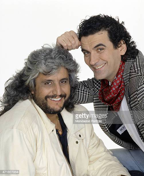 Italian actor and director Massimo Troisi smiling beside Italian singersongwriter Pino Daniele 1991