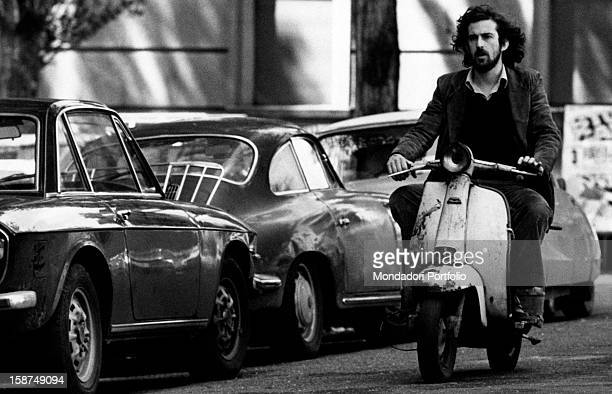 Italian actor and director Nanni Moretti riding a vespa scooter Rome 1978