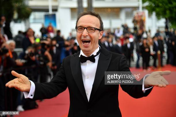 Italian actor and director Roberto Benigni arrives on May 13 2018 for the screening of the film 'Happy As Lazzaro ' at the 71st edition of the Cannes...