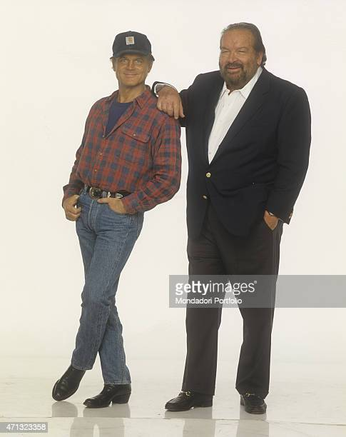 Italian actor and director Terence Hill with a Carhartt cap smiling beside Italian actor and swimmer Bud Spencer 1994