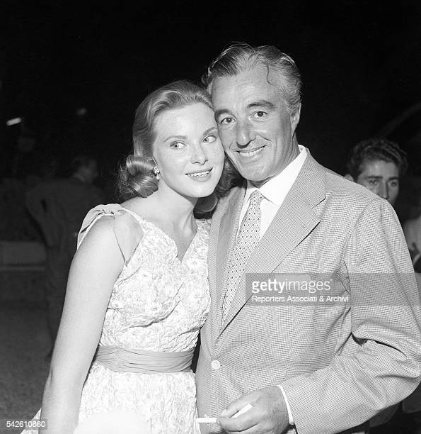 Italian actor and director Vittorio De Sica and American actress Natalie Trundy at the Titanus party for the movie Montecarlo 1956
