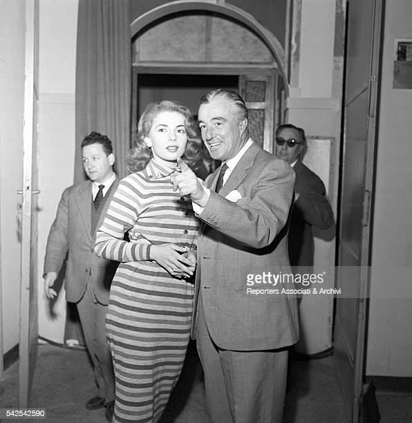 Italian actor and director Vittorio De Sica and American singer and actress Abbe Lane during a break on the set of Time of Vacation 1956