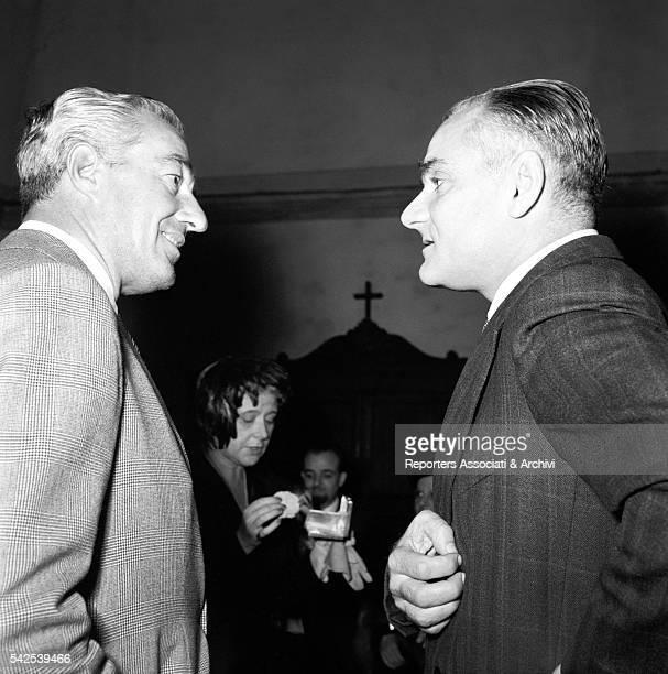 Italian actor and director Vittorio De Sica and Italian writer Alberto Moravia talking at a prize ceremony 1953