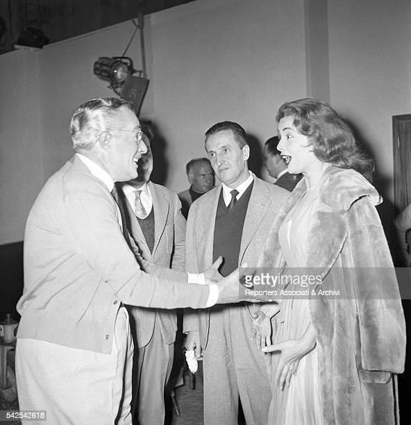 Italian actor and director Vittorio De Sica Italian screenwriter Luigi Zampa and American singer and actress Abbe Lane talking during a break on the...