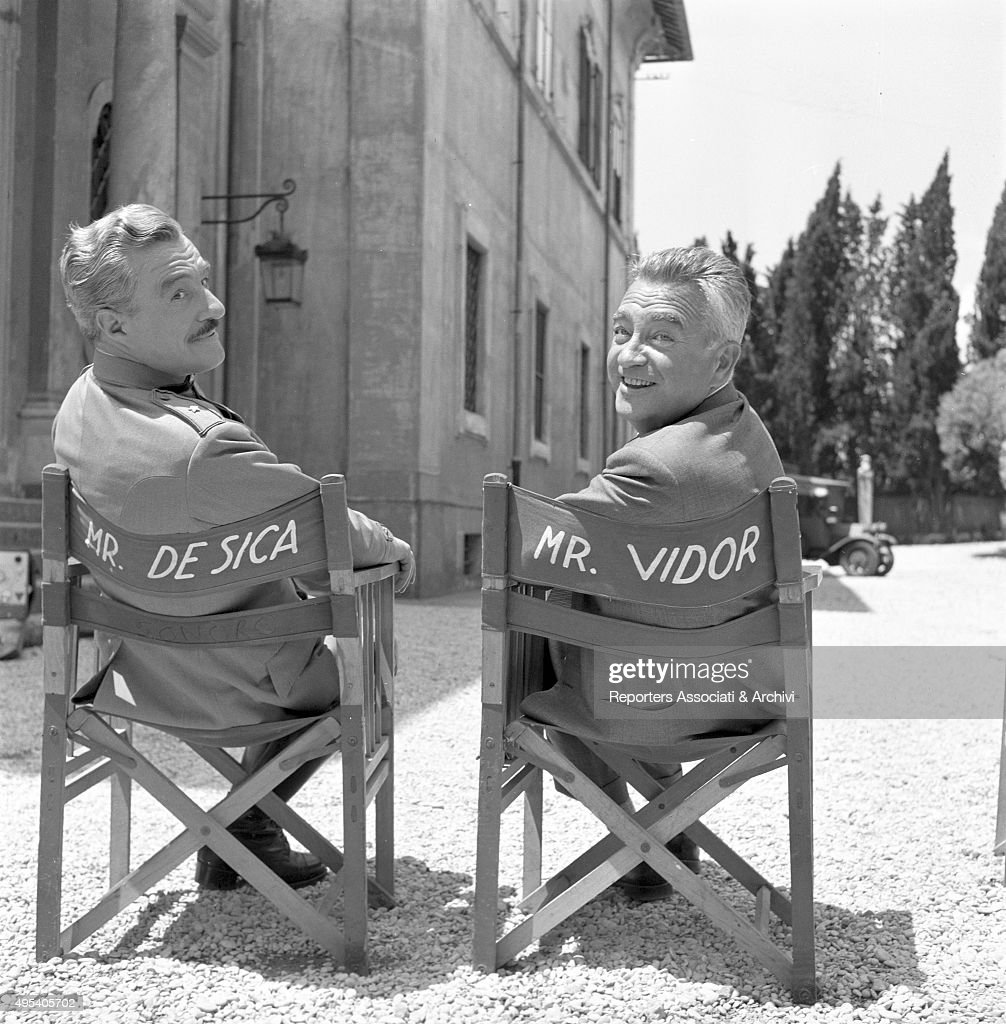 Italian actor and director Vittorio De Sica posing with American director Charles Vidor on the set of the film A farewell to arms. Italy, 1957