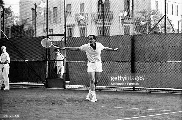 Italian actor and director Vittorio Gassman playing tennis Venice 1966