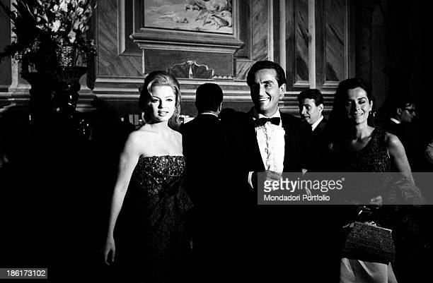 Italian actor and director Vittorio Gassman smiling beside beside British actress Margaret Lee and French actress Juliette Mayniel Vittorio Gassman...